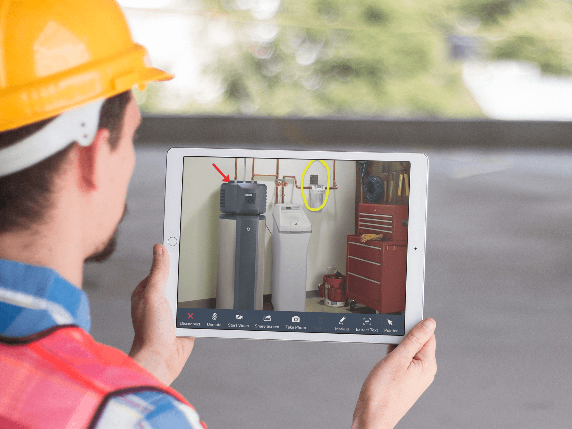 ipad-pro-mockup-held-in-landscape-position-by-a-construction-worker-a12431